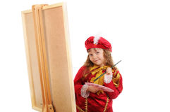 The girl with a brush and paints near an easel Royalty Free Stock Images