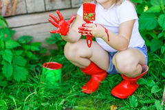 Girl with a brush with red paint, Royalty Free Stock Photos