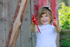 Girl with a brush with red paint, Royalty Free Stock Images