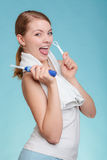 Girl with brush and tongue cleaner. Stock Photos