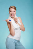 Girl with brush and tongue cleaner. Royalty Free Stock Photos