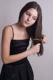 The girl brushes hair Stock Photo