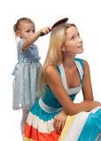 Girl brushes hair of mum Royalty Free Stock Images