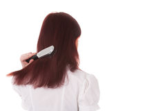 Girl brushes her hair Stock Image