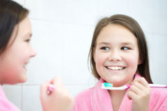 Girl brushes her teeth Stock Photo