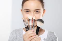 Girl with brushes for make-up Royalty Free Stock Image