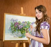 Girl with brushes near  easel Stock Photo