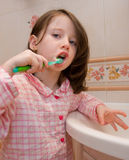Girl brushes teeth Royalty Free Stock Photography