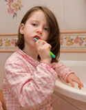 Girl brushes teeth Stock Image