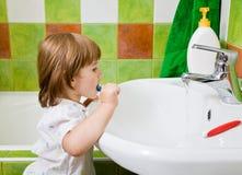Girl brushes teeth. Royalty Free Stock Photo