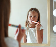Girl brushes teeth Royalty Free Stock Photos