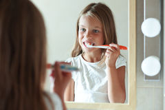 Girl brushes teeth Stock Photo