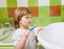 Girl brushes teeth. Royalty Free Stock Images