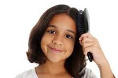Girl Brushing Hair Royalty Free Stock Images