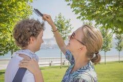 Girl brushing her hair boy Royalty Free Stock Image