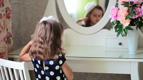 Girl is brushing her hair. FullHD video Royalty Free Stock Photo