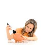 Girl brushing her piggy bank Royalty Free Stock Photo