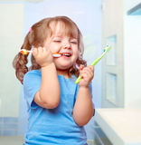 Girl brushing her teeth Royalty Free Stock Photography