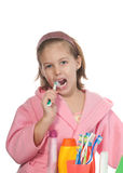 Girl   brushing her teeth Royalty Free Stock Image
