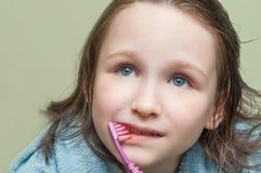 Girl brushing her teeth Royalty Free Stock Photos