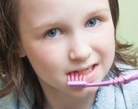 Girl brushing her teeth Royalty Free Stock Image