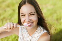 Girl Brushing her Teeth Royalty Free Stock Images