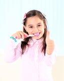 Girl brushing her teeth. Stock Images