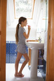 Girl brushing her teeth Royalty Free Stock Images