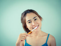 Beautiful girl brushing her teeth royalty free stock photography