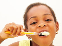 Girl brushing teeth stock photography