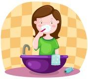 Girl brushing teeth Royalty Free Stock Images