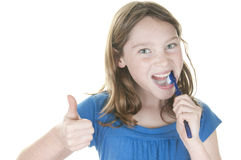 Girl brushing teeth Stock Images