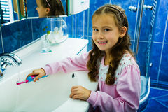 Girl brushing teeth 2 Stock Photography