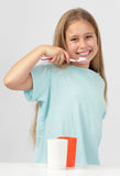 Girl brushing teeth Stock Image