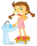 A girl brushing teeth Stock Photo