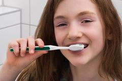 Girl Brushing Teeth Royalty Free Stock Photo