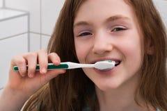 Girl Brushing Teeth Royalty Free Stock Photo