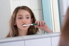 Girl Brushing Teeth Royalty Free Stock Photos