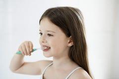 Girl Brushing Teeth Royalty Free Stock Photography