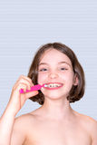 Girl brushing teeth, isolated. Stock Image
