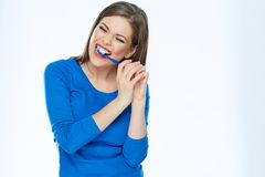 Girl brushing teeth. young woman with toothy brush. White background isolated Stock Photography