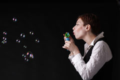 Girl with bubble. Young girl with bubble gum. Image isolated on black background Stock Images