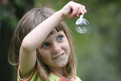 Girl with bubble 2. Girl with bubble and wand royalty free stock image