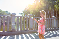 Girl with bubble blower. Royalty Free Stock Images