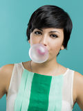 Girl with a bubble gum Stock Images