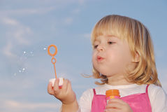 Girl with bubble wand Stock Image