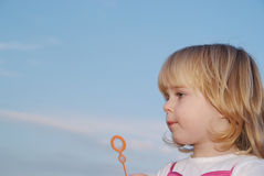 Girl with bubble wand Royalty Free Stock Images