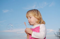 Girl with bubble wand Stock Images