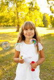 Girl with bubbles Stock Photo