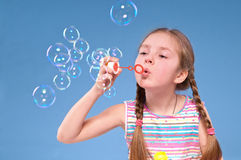 Girl and  bubbles. Little girl blowing soap bubbles Royalty Free Stock Photos